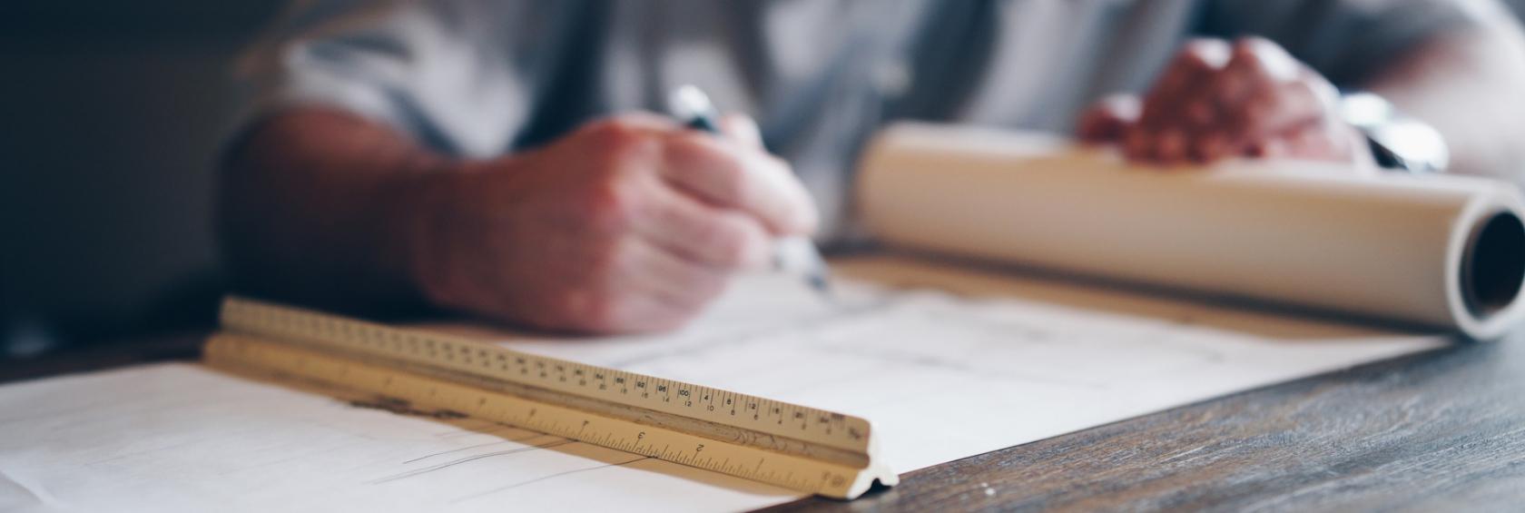 Architect / Engineer designing blueprints