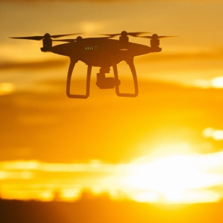 Flying drone at sunset